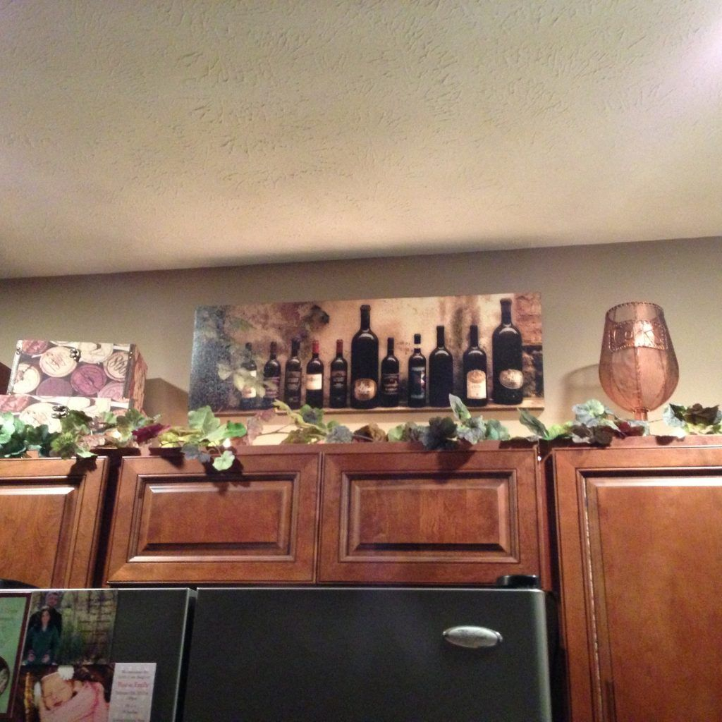wine decorations for above kitchen cabinets. i can add our trip