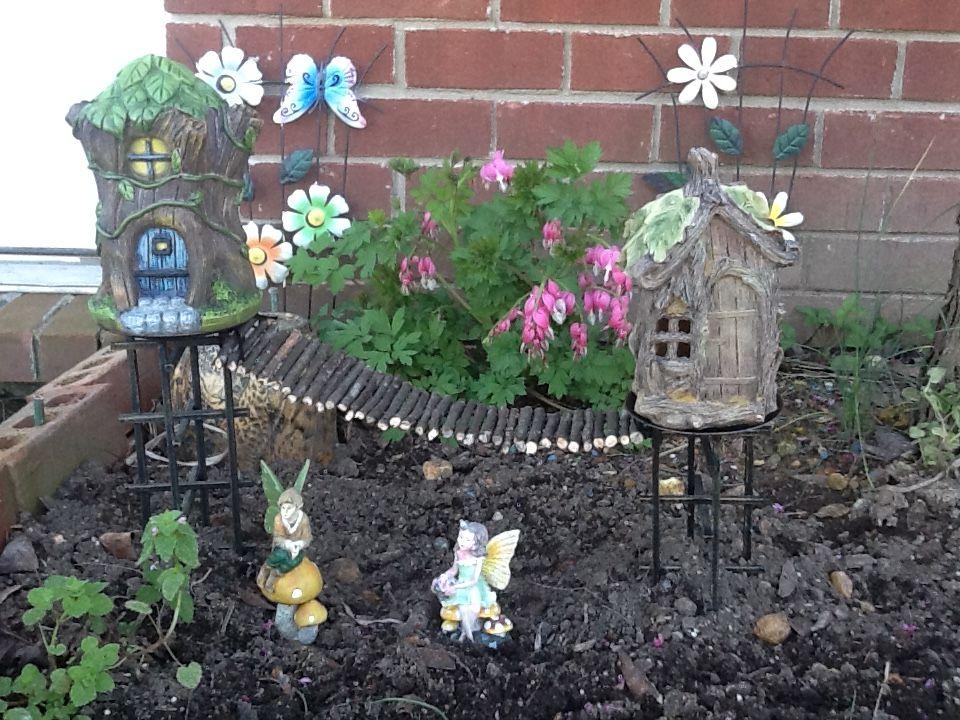 Fairy garden houses; diy fairy bridge made with sticks