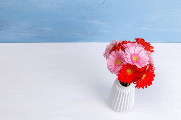 Gerbera Flowers In Vase On Wooden Background Likeagod Pinterest