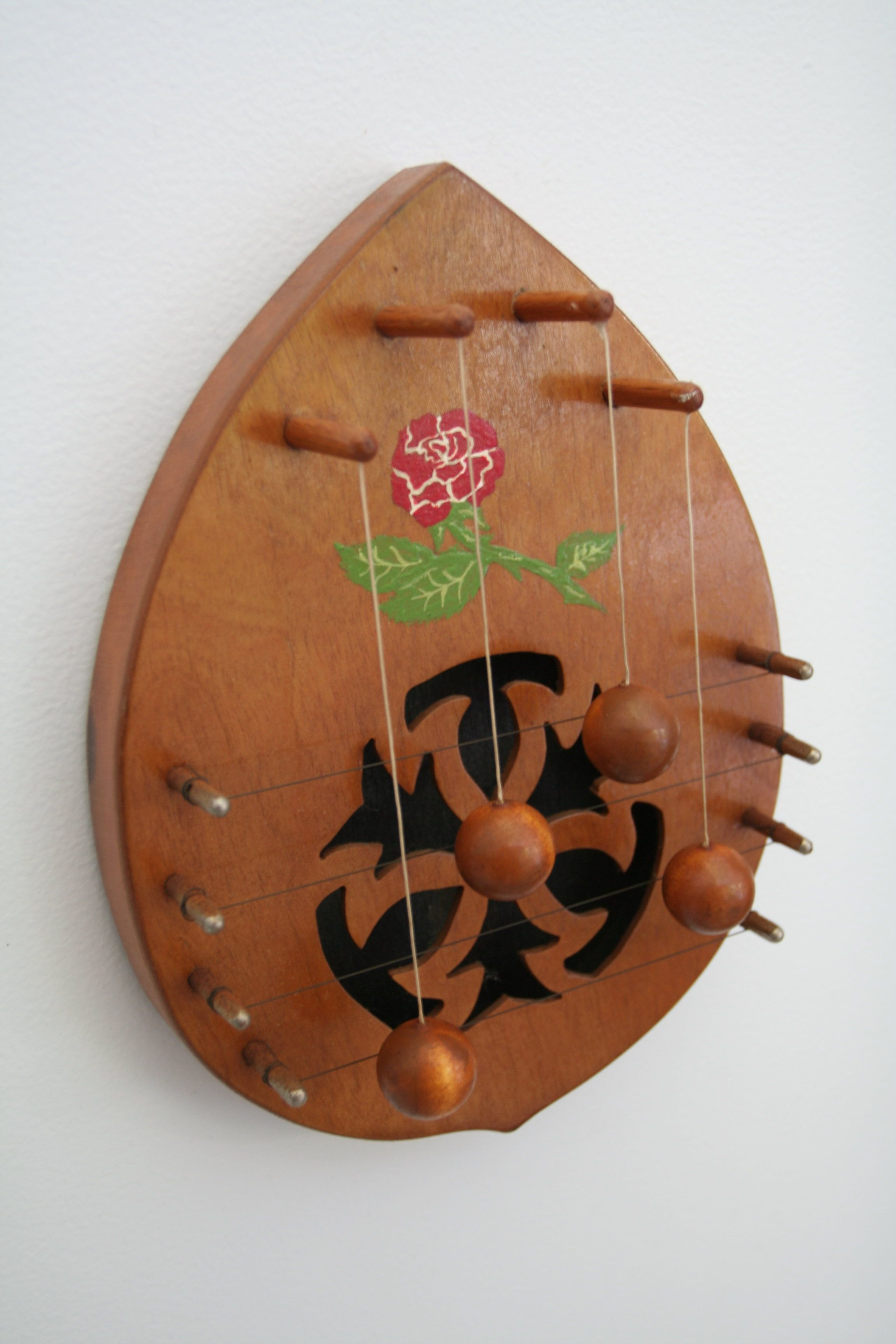 This is a door harp. It can be hung on the backside of a door & This is a door harp. It can be hung on the backside of a door ... pezcame.com