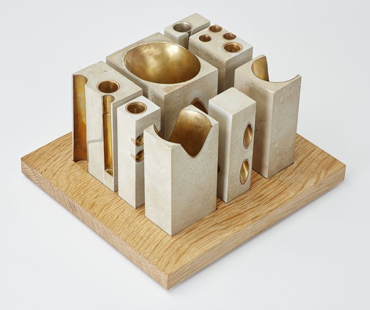 Allied Works Architecture, National Music Centre concept model, 2009. Modeling concrete, salvaged brass instruments, oak base. 7 x 6 x 4.5 in. Courtesy Allied Works Architecture. - On view in Case Work | Denver Art Museum