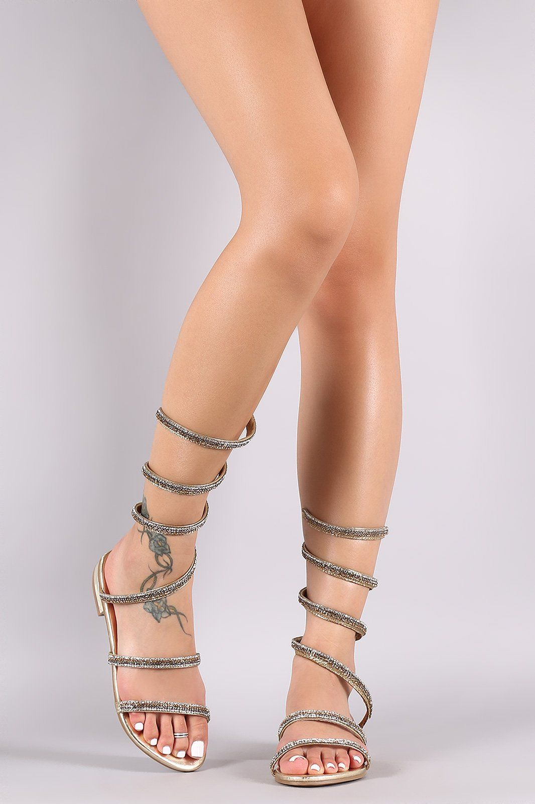 5084a9dce This fabulous flat sandal features an open toe silhouette ...