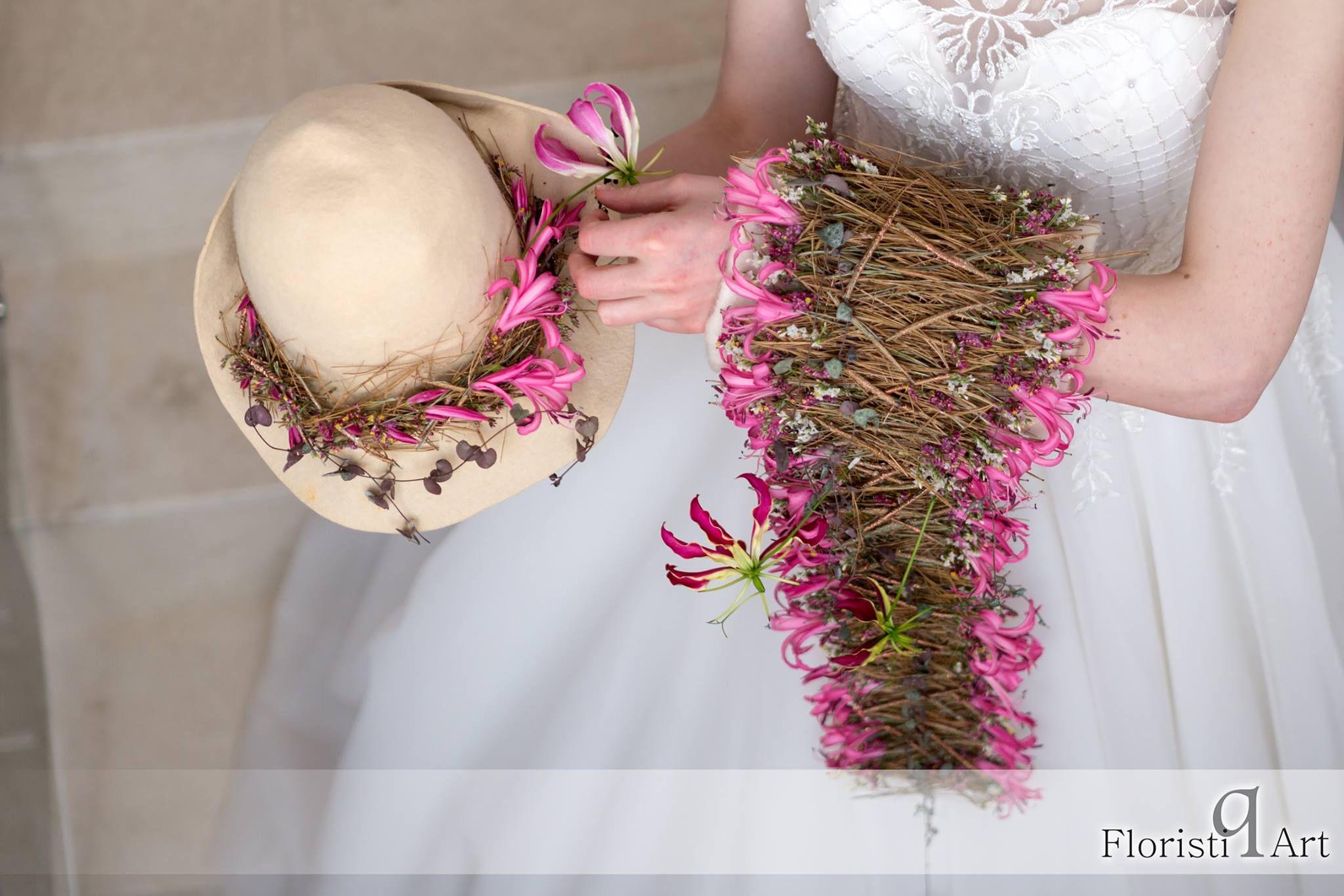 Floral Designer: Andreea Stör MUA: Ioana Malai Model: Veronika Onea Photo credit: Zsolt Gabriel Horvath Dress: Maya-Rochii de mireasa Event: Bloom Your Business — at Floristiq Art International.