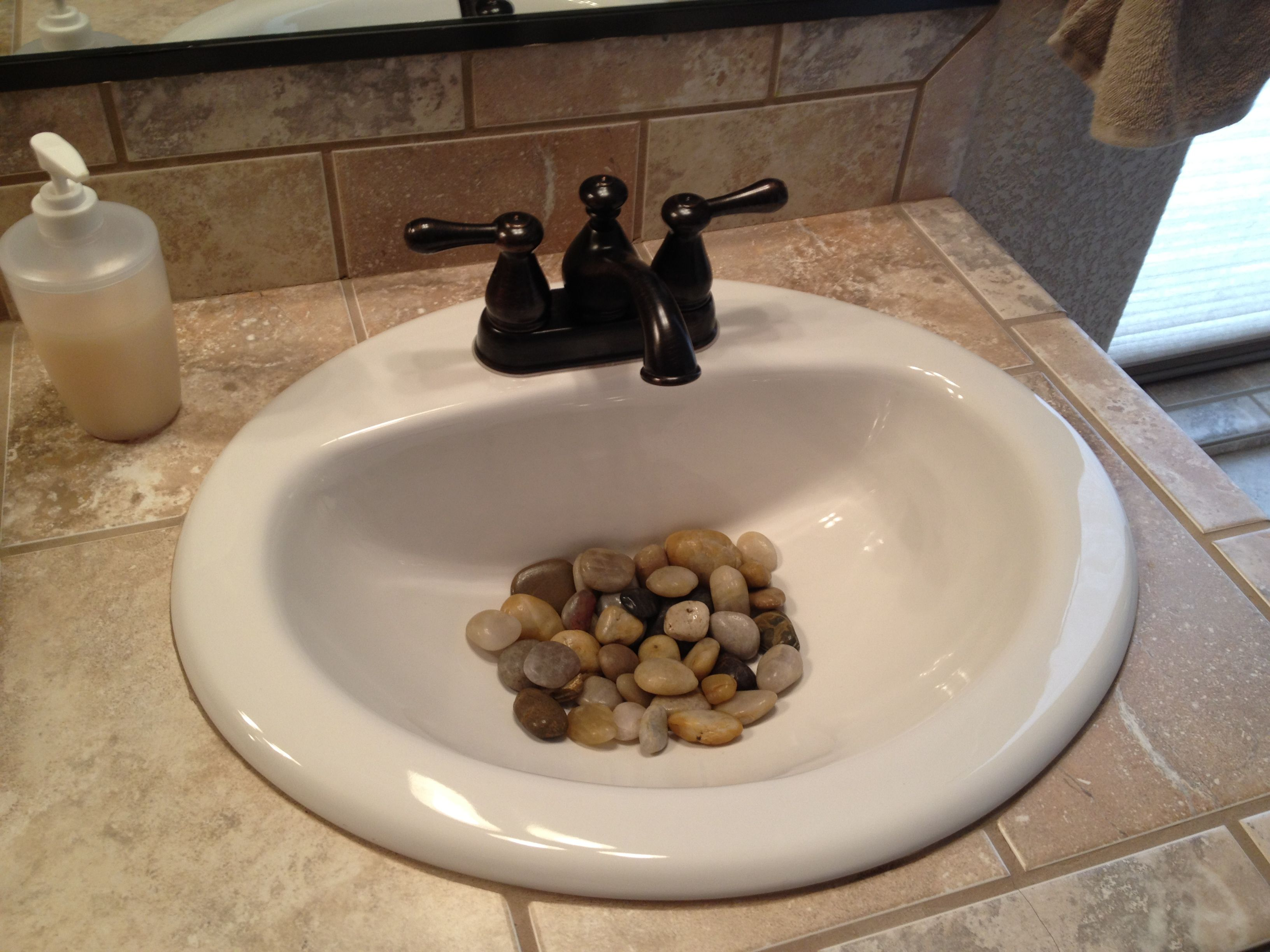 River Rocks In The Bathroom Sink A Little Feng Shui But Neat Way To Decorate Too