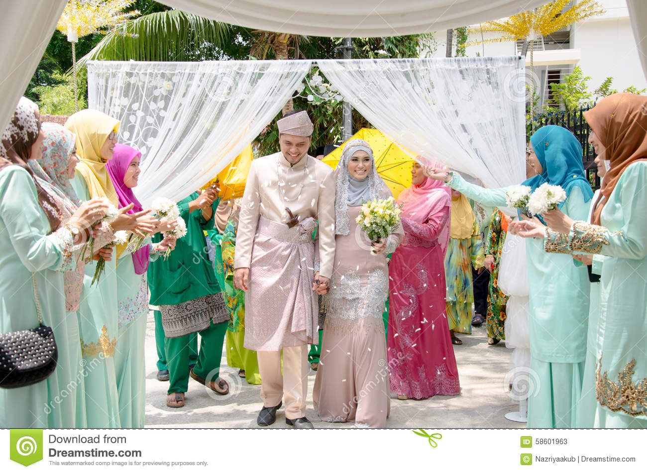 Kuala Lumpur Malaysia March 22 2014 Malay Wedding A Malaysian Couple Newly Wed Holding Hands And Walking Is Being Co Malay Wedding Wedding Wedding Events