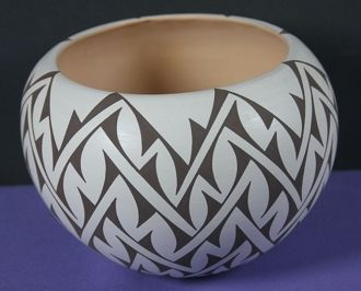 SAVVY SALE Geometric design on whiteware bowl by Gabriel Paloma. This lively geometric pattern is based on a rhythmic pattern emphasizing negative space.