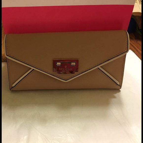 Kate Spade Cyndy Wesley Place Wallet NWOT! No tags, only comes with card care. Never used! Tan color, rare find! kate spade Bags Wallets