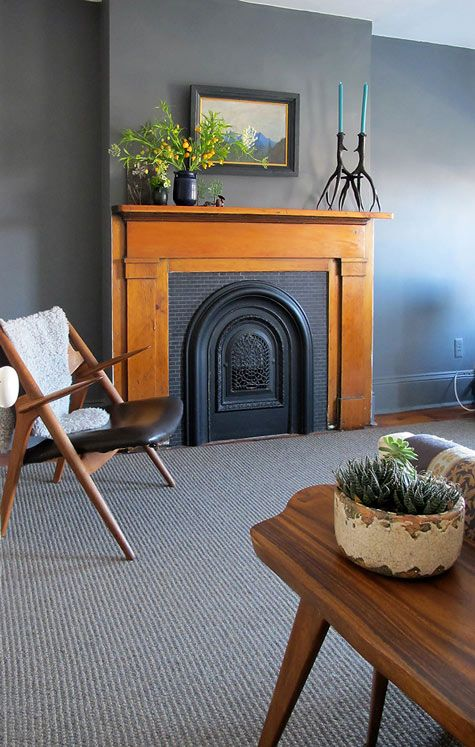 Love this fireplace - the metal surround, the wood mantle, the tile. Perfect.