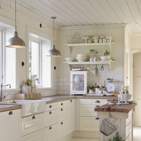 Beautiful white kitchen, perfect for anyone who likes rustic or country decor! #Boisavita #wood4life #customproject #montrealreno #montrealkitchen