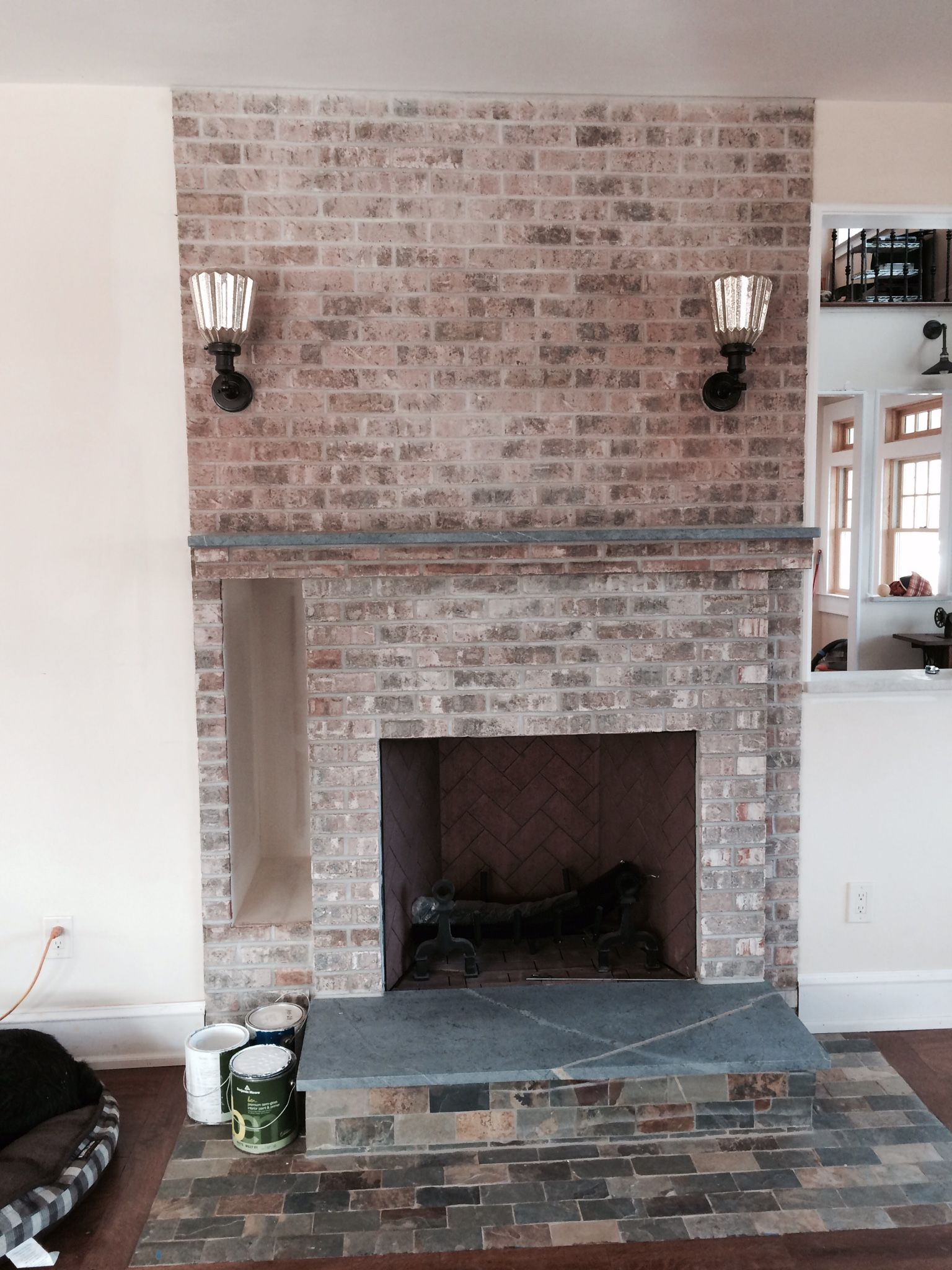 installation of a soapstone fireplace surround by www