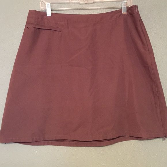 """Patagonia Skort Charcoal gray 100% Polyester, Zipper closure on right side at top. Unzips about 5"""" from bottom on both sides for athletic activity, has pocket on left hip. ( All features in pics) Patagonia Shorts Skorts"""