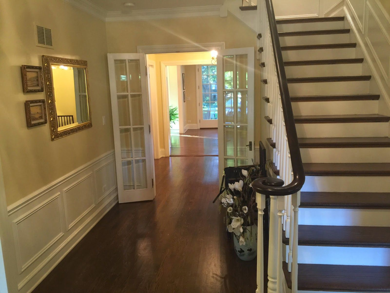 French doors,  stairs, wall panel accents.