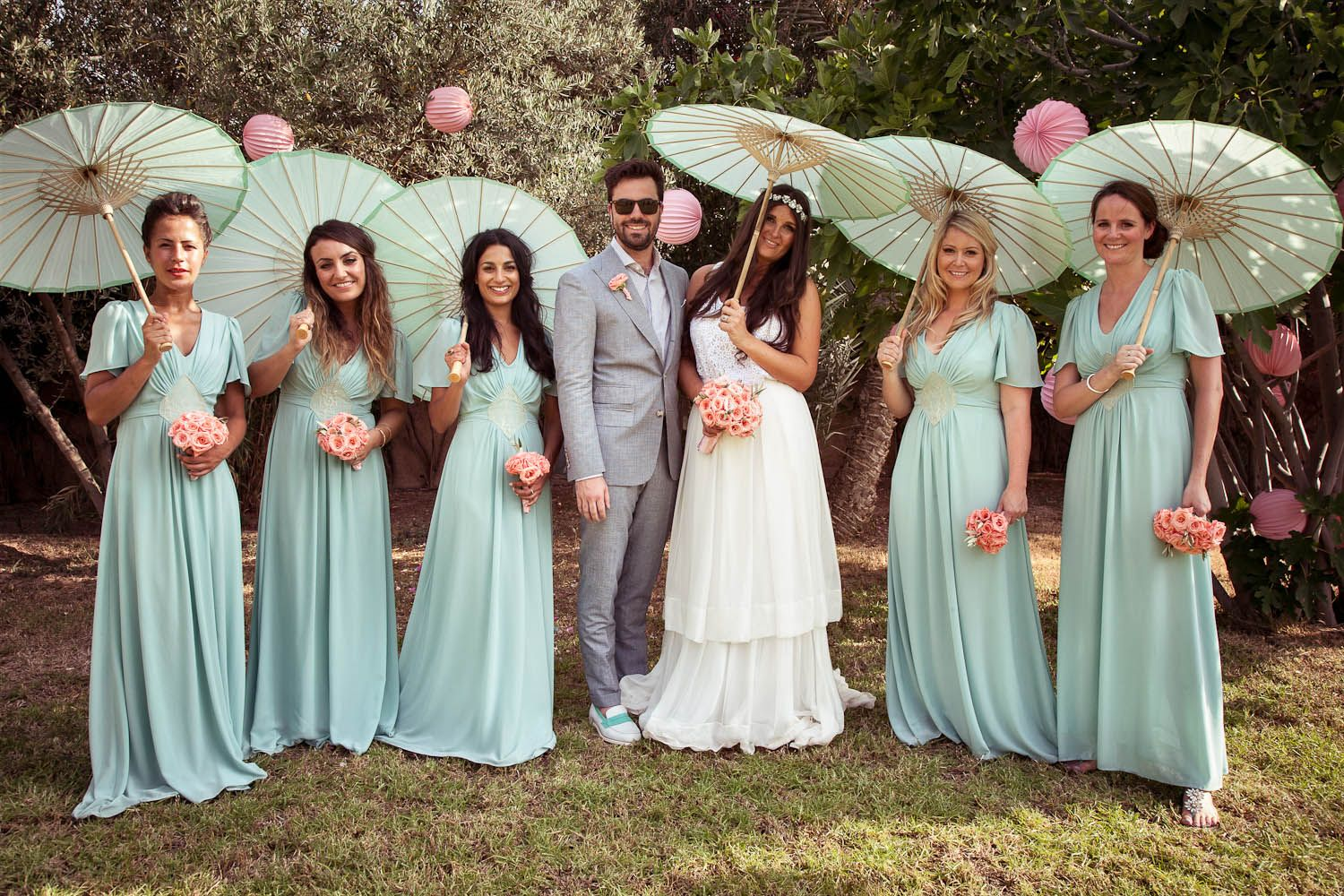 Gorgeous bridal party in pink and pistachio pastels fun garden delphine manivet dress and aquamarine bridesmaid dresses bride and chic ombrellifo Image collections