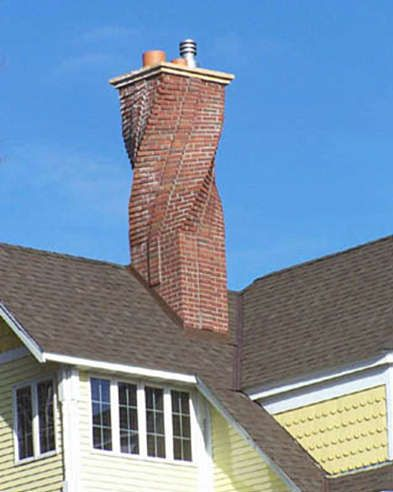 a twisted chimney design and unusual brick work on the roof of a house the - Home Chimney Design