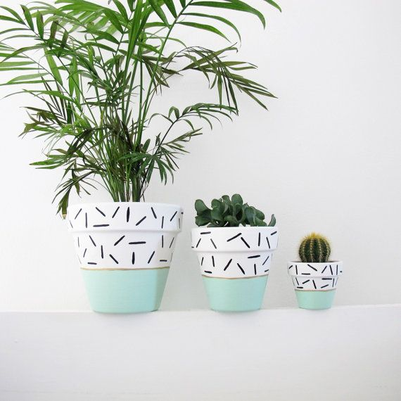 A hand painted plant pot in mint dash design - because plants ...