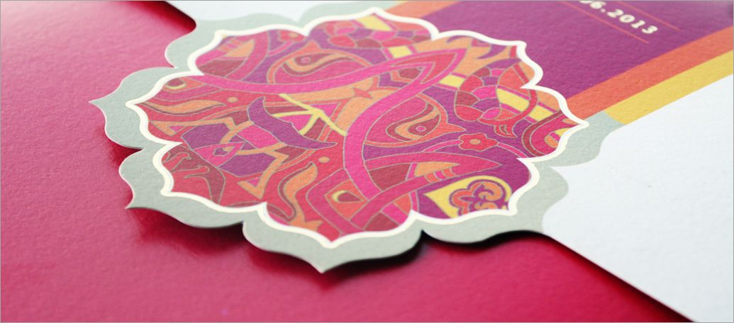 Indian Wedding Invitation With Bright Colors And Floral Motif In A Die Cut The