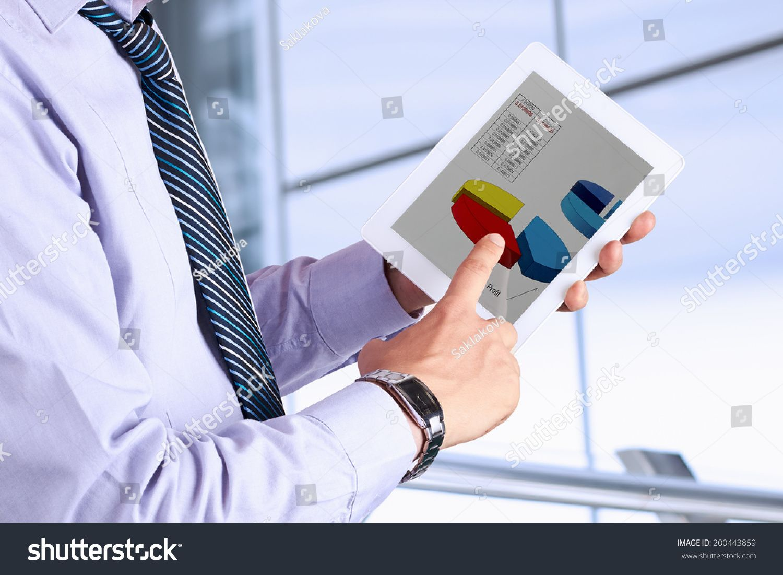 Businessman holding a digital tablet and analyzing financial statistics #Ad , #Sponsored, #digital#holding#Businessman#tablet