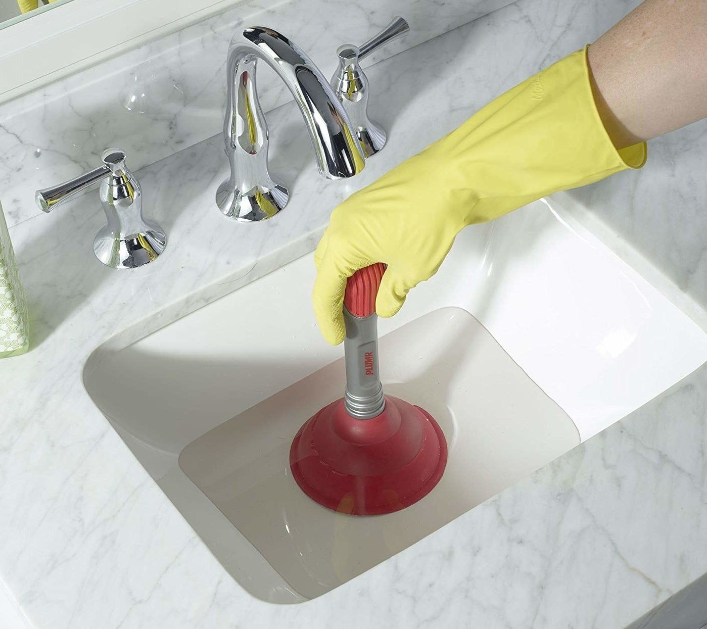 unclog your sink using a sink plunger