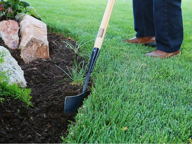 This Manual Lawn Edger Keeps Garden Beds Walkways And Other Spots In The Yard Looking Neat And Tidy Learn How It Makes I In 2020 Garden Edger Lawn Edger Lawn Edging