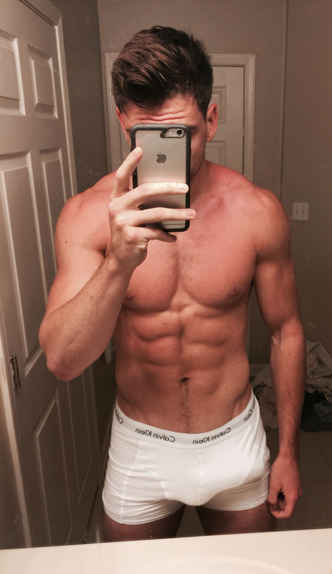 Toned muscle guy in hot briefs on cam