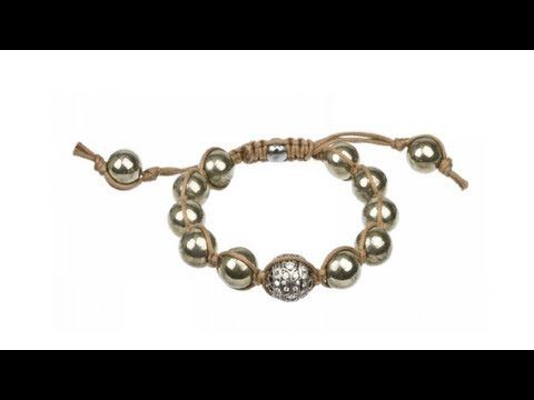 To buy now click on the link: http://shrsl.com/?~3frv  The #Tai #Hand #Braided Brown #Cord #Pyrite Beaded and #Silver Ball #Bracelet features large Pyrite beads with a large silver beaded center piece with a unique cubic #zirconia design based on a hand braided light brown adjustable cord bracelet. Tai #Jewelry's use of colorful beads, intricate hand braiding, and spiritual symbols creates this unique #collection with an overall bohemian feeling.