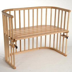 This attaches to the bed    Amazon.com: BabyBay Maxi Cot - Finish: Natural Varnished: Baby