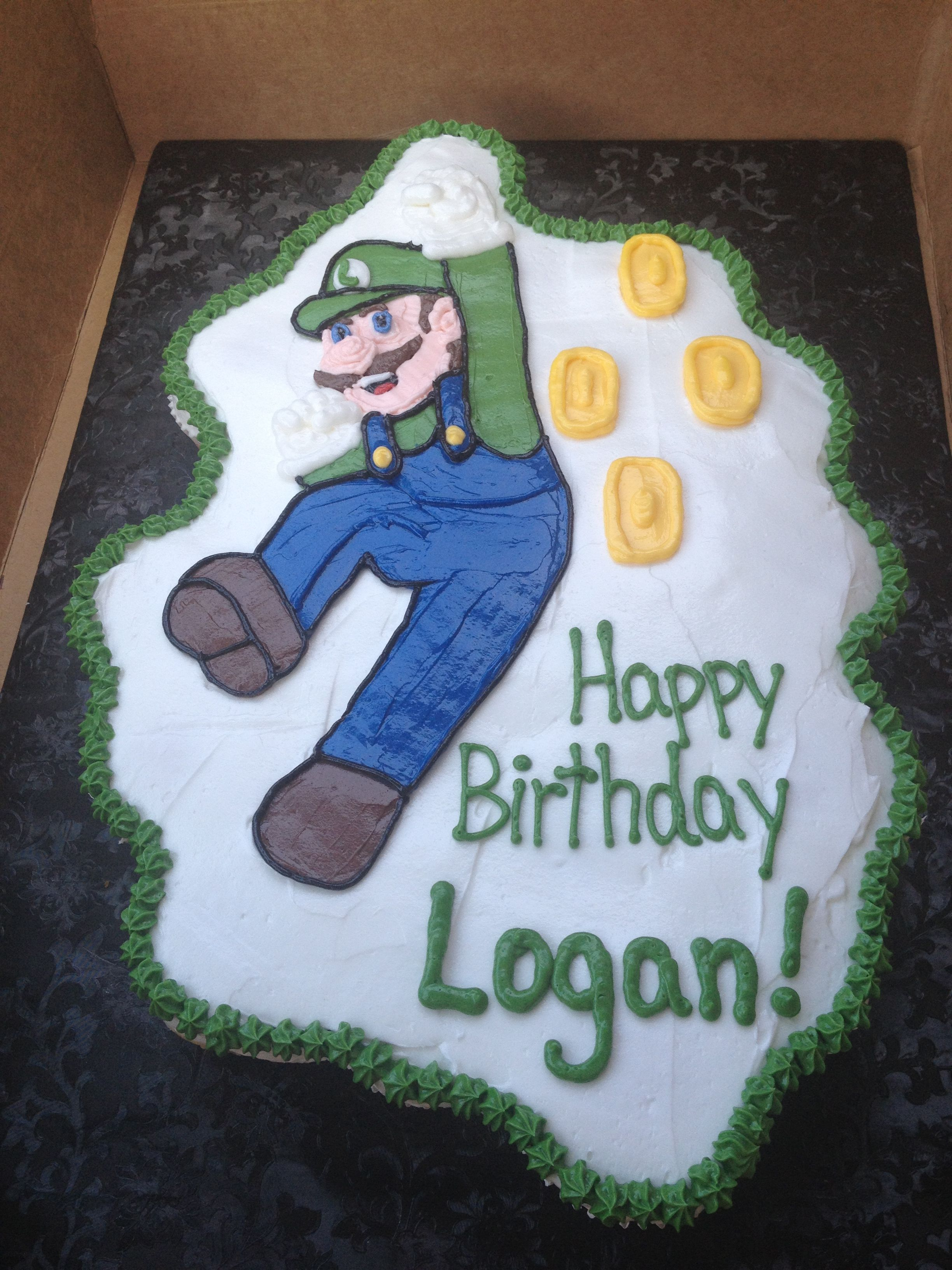Luigi birthday cake we had made for Logan's birthday. It's a cupcake cake so no knives or forks needed.