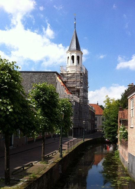 So I had to go see the Elleboogkerk church myself; I hadn't been in that street since they put on the timber roof structure months ago. This photo is from this afternoon, 26 June 2012.