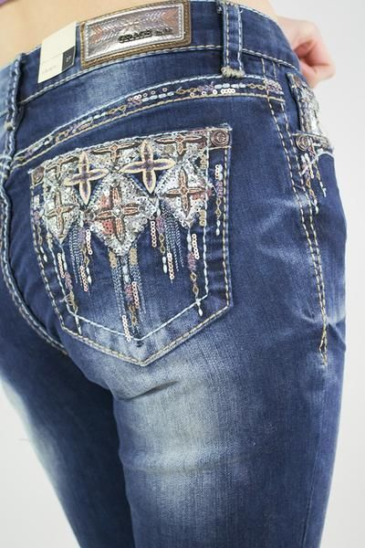 These amazing straight leg easy fit jeans have beautiful copper and brown stitching and sequins on the front and back pockets. Love these! Great medium wash col