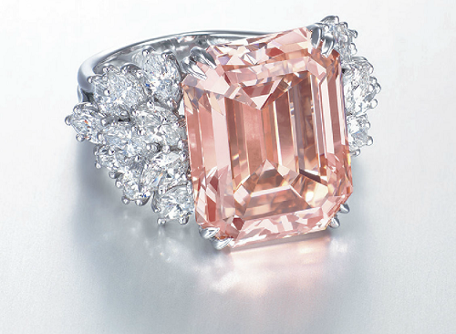 12.93 carat Fancy Orangy Pink VS2 diamond, by Harry Winston. The diamond is set in a floral motif with marquise shaped colorless diamonds set all around. This ring is estimated to sell between $1.6 million and $2.5 million.