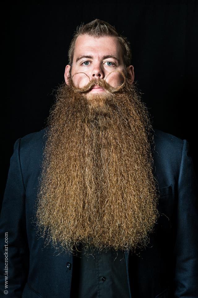 Josh Black, Vice President of the RVA Beard League, proudly displays his award-winning facial hair. (Photo by Iain Crock Art)