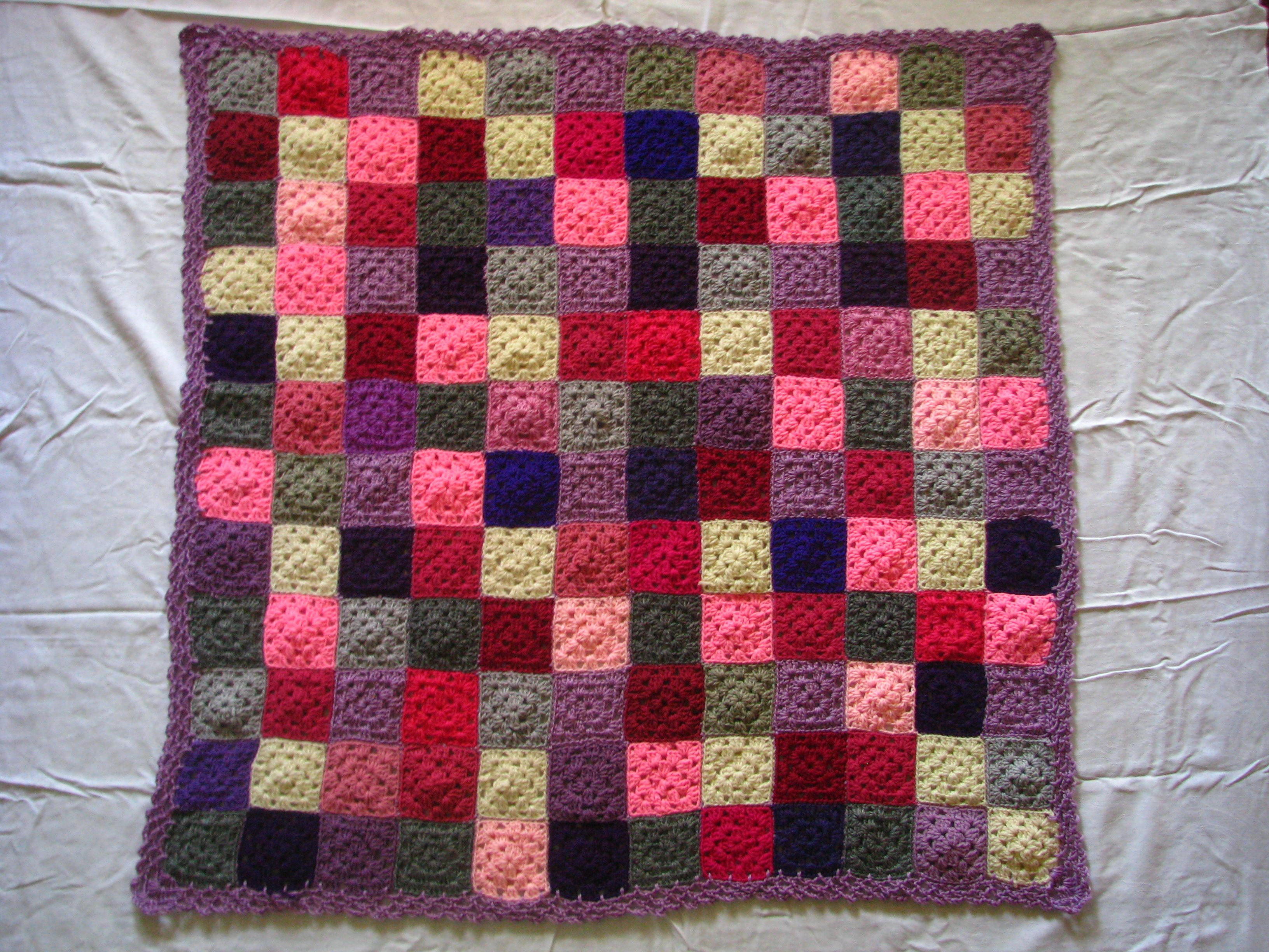 "Mom called this blanket ""Leo's Berry Cobbler"" because it reminded her of her nephew's favorite dessert.  Even with the random placement of granny squares, the pattern hidden throughout is pretty obvious."
