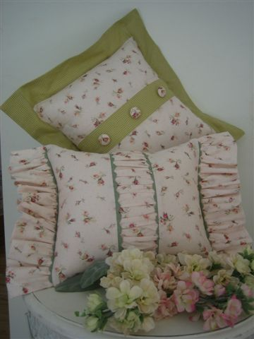 http://ginghamcollection.com.au/images/love%20&%20Charity%20Cushions.jpg