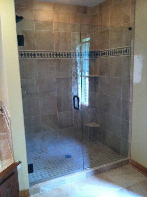 This Warm And Classic Shower Enclosure Benefits From An