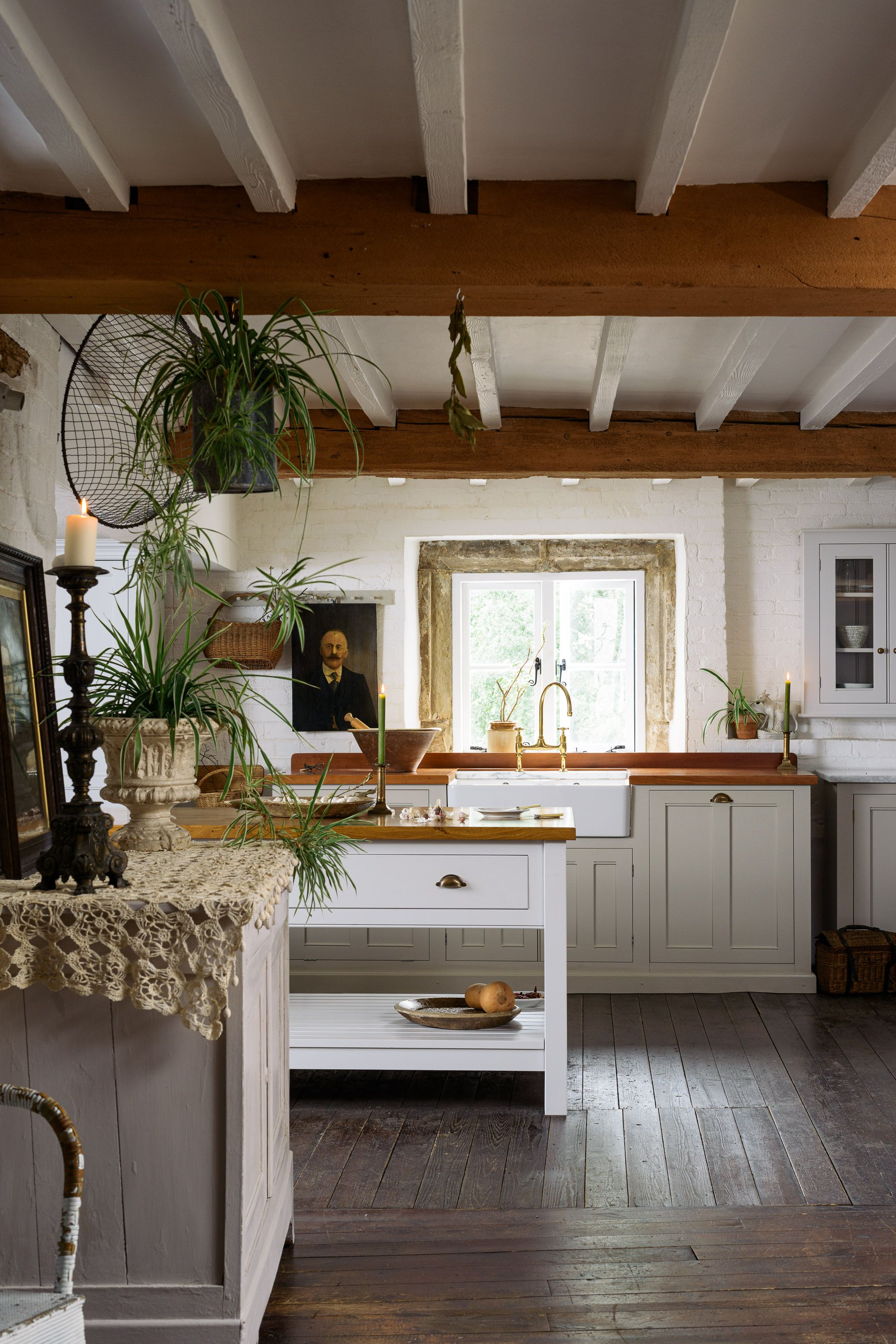 A country kitchen with wooden floors and original beams #countrykitchens