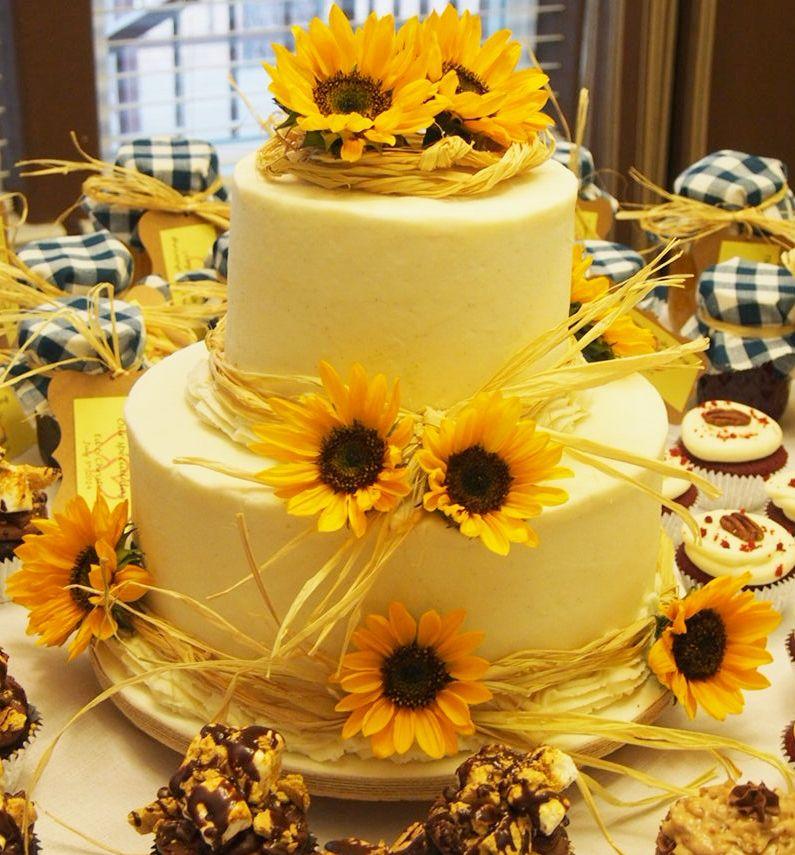 Sunflower wedding cake with fresh sunflowers and wedding