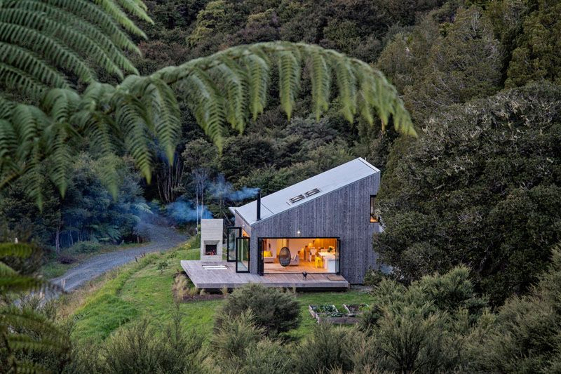 This Small House Sits On A Hillside In New Zealand Architectural