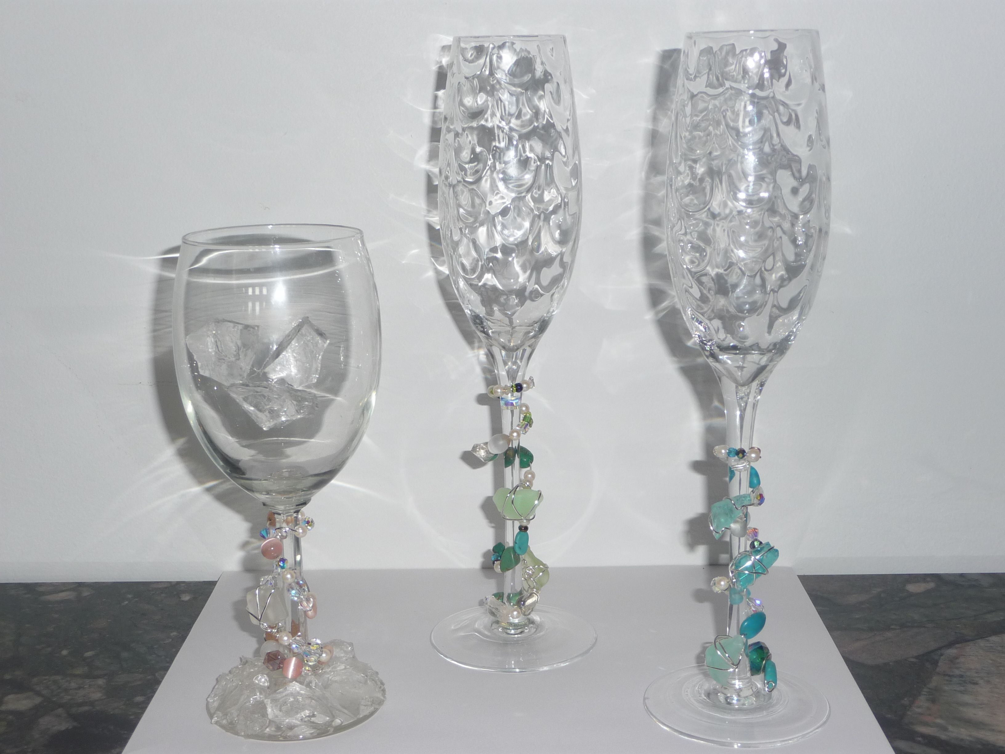 Beautiful wine glass wraps.  Make that wedding day special or a glass of wine.   By Arlene Ring