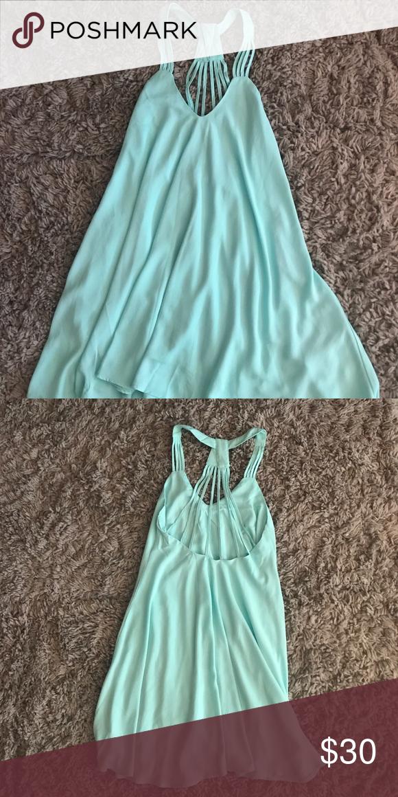 Boutique Party Dress Teal party dress, flare fit, thin straps create back and shoulder detailing Boutique Dresses Mini
