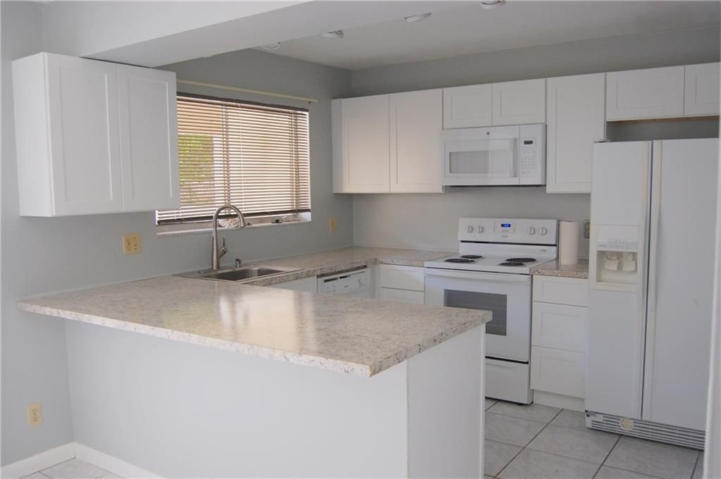 Check Out This 2 Story Townhouse Style Condo In West Palm! Brand New Kitchen  Cabinets Just Installed This Week And This Unit Is Clean And Turn Key.