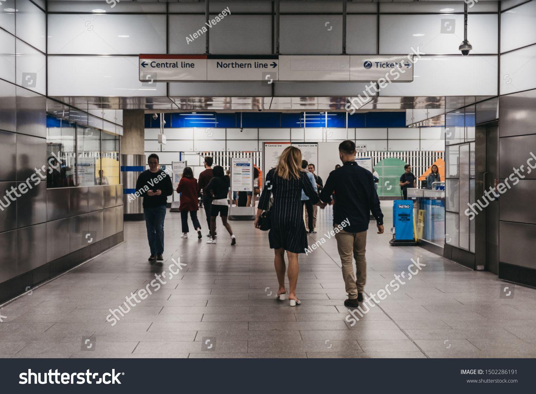 London UK  August 31 2019People entering Tottenham Court Road London Underground station platform motion blur selective focus London Underground is the oldest underground...