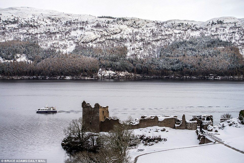 Snow covered Urquhart Castle on the banks