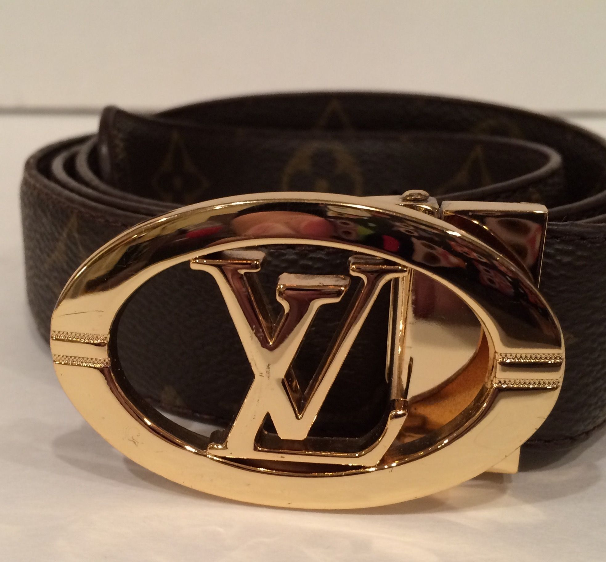 755cea2af10 Monogram LV Circle Belt. Get the lowest price on Monogram LV Circle Belt  and other fabulous designer clothing and accessories! Shop Tradesy now