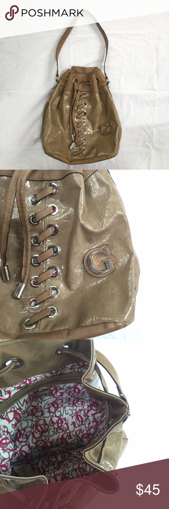 Guess Shoulder Bag Chic tan shoulder bag from Guess. Glossy material makes it easy to clean. Medium size holds every day essentials and can even fit a tablet. A little wear on the draw strings but barely noticeable. Rarely used! Guess Bags Shoulder Bags