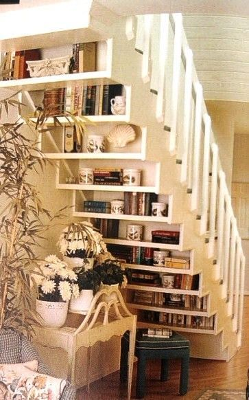 bookshelves behind stairs