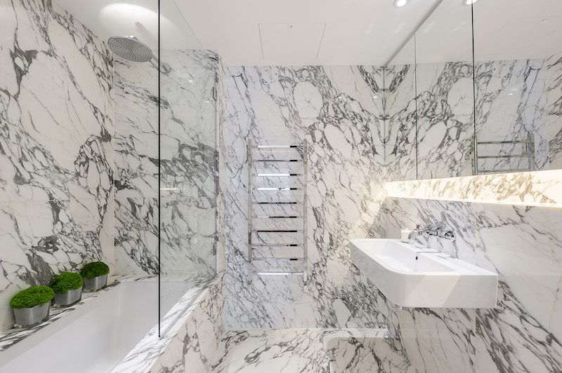 Marble filled bathroom, by Design Box London