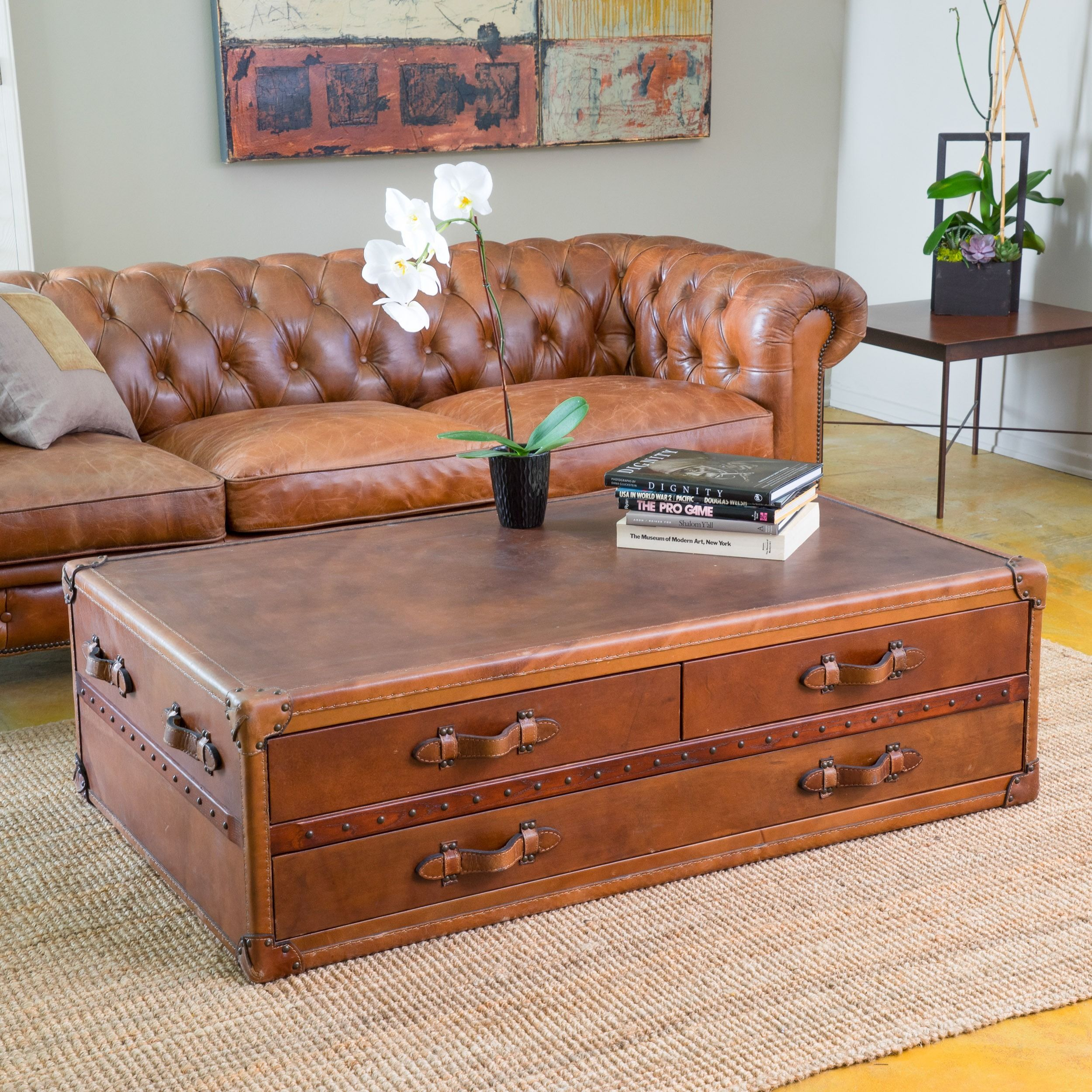pacific living room coffee table trunk chest elegant set upholstered in top grain leather with antique stud detailing the quality of this will make a statement any your home