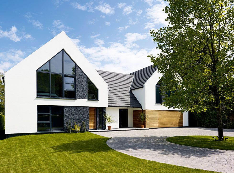Stuart And Elmarie Ward Have Created An Impressive Contemporary Family Home On A Budget Thanks To A Radi Building A House Modern Bungalow House Bungalow Design
