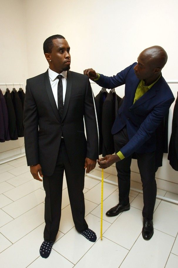 Sean Combs is measured for a suit by Ozwald Boateng at the Ozwald Boateng store in London, England.