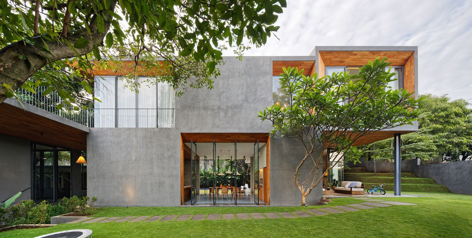 The concrete cladding contrasts with warm orange teak modern house design dream also photo of in this abode embraces indonesia   tropical rh pinterest
